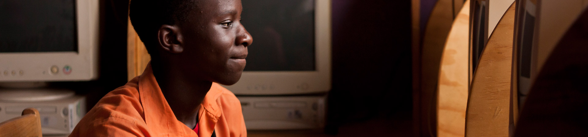 Raise a Smile - school pupil learns in computing lessons - education in Zambia