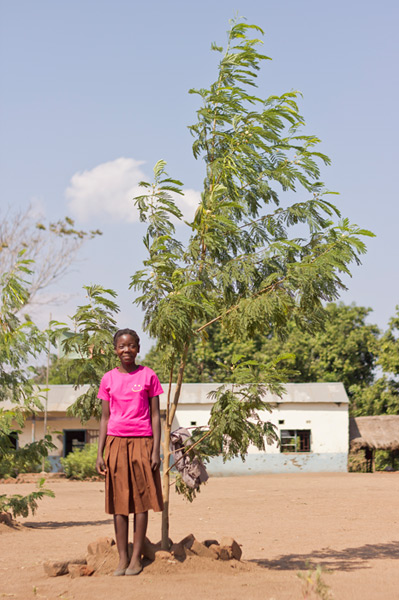 raise a smile tree plantikng project - pupil with lukina tree
